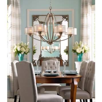 High drama and low profile merge effortlessly in this traditional dining room.