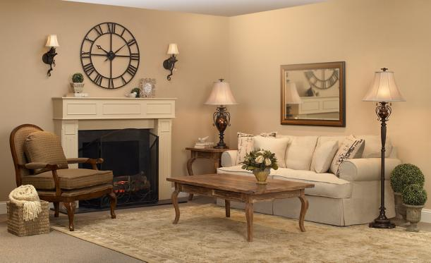 traditional living room, upholstered furniture, wall sconces, wall clock