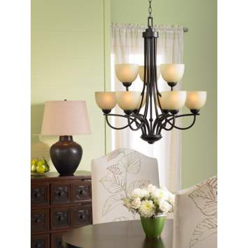 Put a table lamp near a chandelier for a luxe dining room lighting idea.