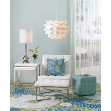 Blue and white hues plus whimsical patterns create a contemporary design.