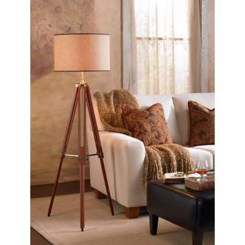 A tripod lamp makes a handsome design statement in a traditional living room.