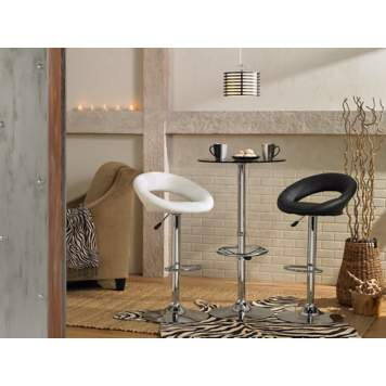 Contemporary bar stools liven up a plain dining room picture.