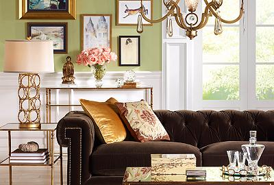 A velvet sofa with tufting is the luxurious centerpiece of this living room.
