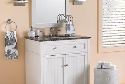Soft colors and rustic furniture make a sweet country cottage bathroom retreat.