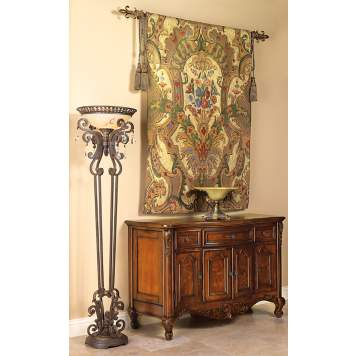 The gold and beige wall tapestry is the statement piece in the entryway design.