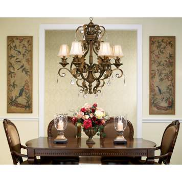 A classic chandelier makes this traditional dining room picture perfect.