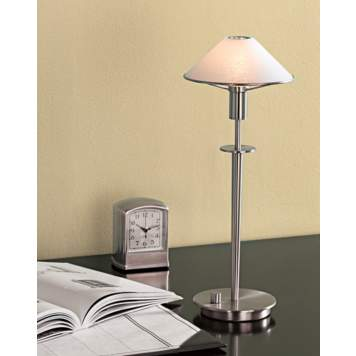 A desk lamp with a built-in dimmer adds functionality to the home office.