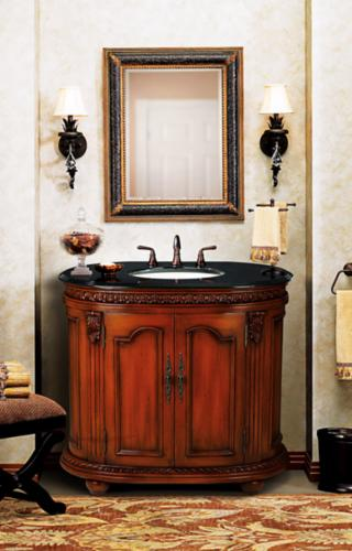 Dark granite counter top in a traditional bathroom.
