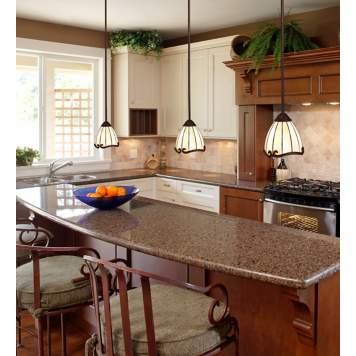 Art Nouveau style pendant chandeliers make this traditional kitchen Trad Chic.