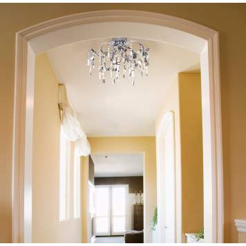 A funky chandelier makes a statement in a transitional-style hallway.