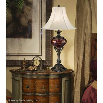 The tortoise shell urn table lamp stands out in the traditional room scene.