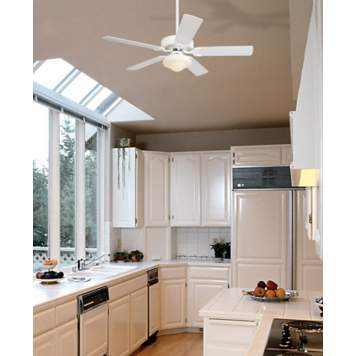 Cool and classic, a white ceiling fan is a kitchen design staple.