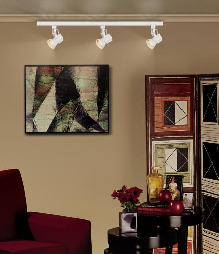 A track lighting system illuminates living room wall art. - Room ...