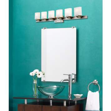 Teal and chocolate brown is a bold color scheme for a contemporary bathroom.