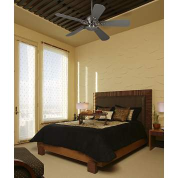 The Casa Fusion ceiling fan draws attention to the bedroom's high ceiling.