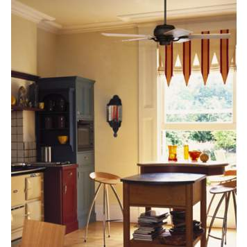A ceiling fan with maple veneer blades adds warmth to this kitchen decor.