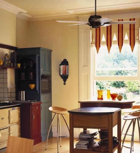 Ceiling fan adds warmth to this kitchen decor.