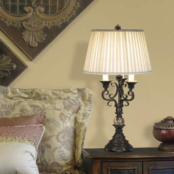 The scroll arm table lamp adds an interesting pattern to the bedroom design.