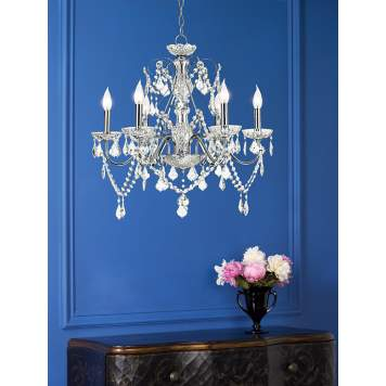 The crystal chandelier is a bold element when juxtaposed with the blue wall.