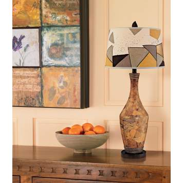Textured art and accessories create a rich, worldly look in an entryway.