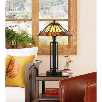 In this picture, an arts and crafts lamp brings color into the room.