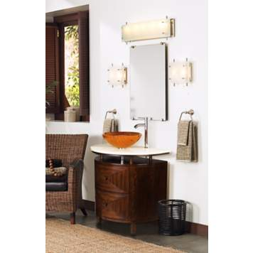 A contemporary bathroom vessel sink in colorful orange.