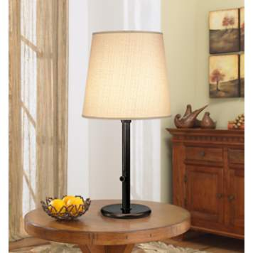 This table lamp, with a soft muslin shade, is a tasteful complement to any room.