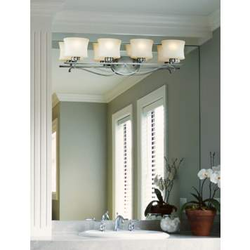 Mounting a light fixture directly on the mirror is a great use of a small space!