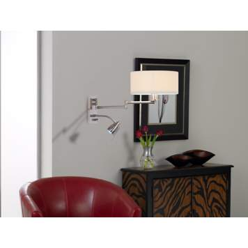 A wall mounted swing arm lamp is a contemporary living room design idea.