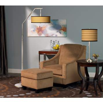 The combination of the arc floor lamp and table lamp creates a dynamic space.