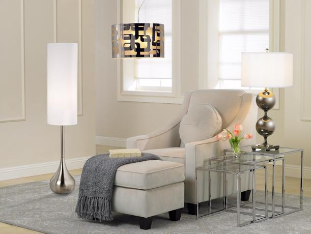 warm hues, soft textiles, gray area rug, upholstered furniture, light fixtures,