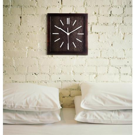 A Wall Clock in a Bedroom Picture