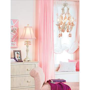 The light pink girl's bedroom is both feminine and chic.