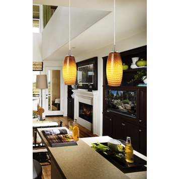 Colorful contemporary pendant lights add interest to a black and white room.