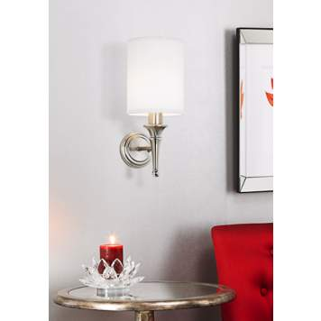 This transitional wall sconce picture showcases Hollywood glam style.