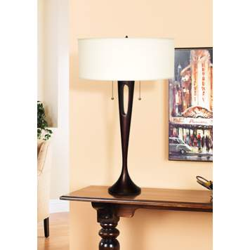 Accent a traditional sideboard with a sweeping contemporary lamp.