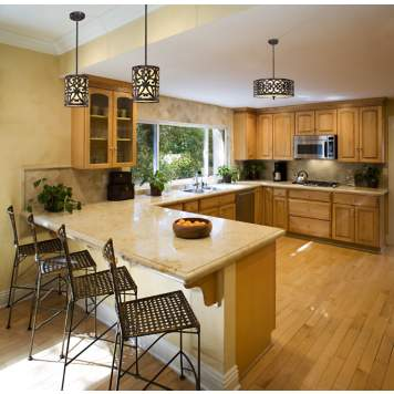 A kitchen picture featuring elegant filigree light fixtures.