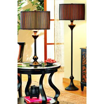 An exotic pair of lamps with bamboo shades creates a rich and worldly look.