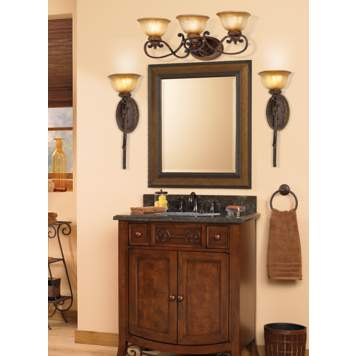 The rich hues and dark wood tones create a traditional bathroom vanity.