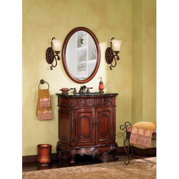 Antique finishes give this bathroom picture its traditional feel.