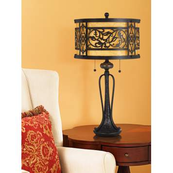 An ornately designed table lamp is the focus in this traditional living room.