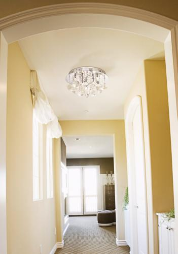 Sunny yellow paint livens up a plain hallway. - Lighting & Decor