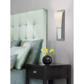 Wall mounted sconces are a great alternative to table lamps in a bedroom design.