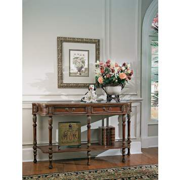 A hallway console offers display space and storage space to control clutter.