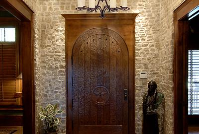 Natural stone and rich woods create a dignified first impression in an entry.