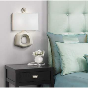 This Jonathan Adler wall sconce serves as both accent lighting and wall art!