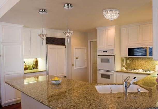 Crystal lighting in a traditional kitchen design.