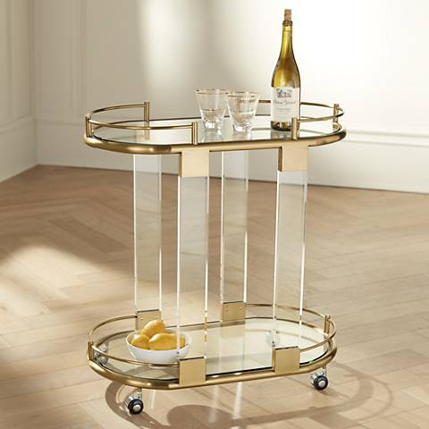 Adaline Clear Acrylic and Gold Oval Bar Cart