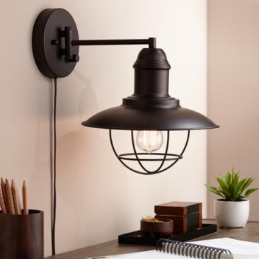Amqui Bronze Cage Shade Plug-In Swing Arm Wall Lamp