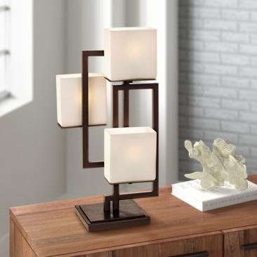 Lighting on the Square Roman Bronze Metal Accent Table Lamp